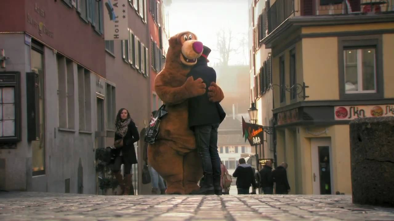 Everyone Gives The Bear A Hug, But When The Costume Comes Off, You Will Be Changed.