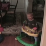 Their Toddler Comes Around The Corner, But He's Not Alone. See Who He's Tagging Behind!